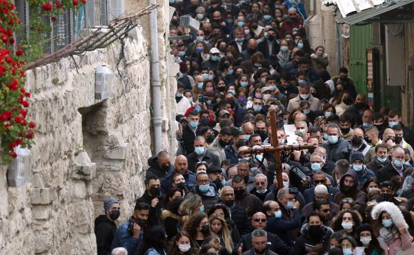 Christian worshippers carry a wooden cross on Friday along the path where tradition says Jesus took his final steps before his crucifixion in Jerusalem's Old City.