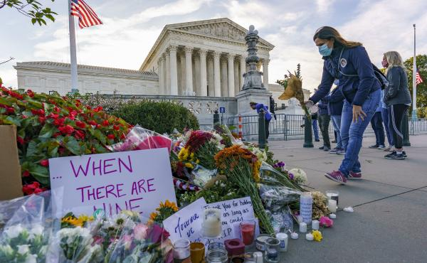 People gather at the Supreme Court on the morning after the death of Justice Ruth Bader Ginsburg.