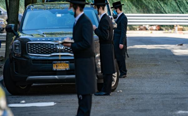 Hassidic Jews Socially distancing on a Willamsburg street during Saturday morning shabbat prayers on May 2.