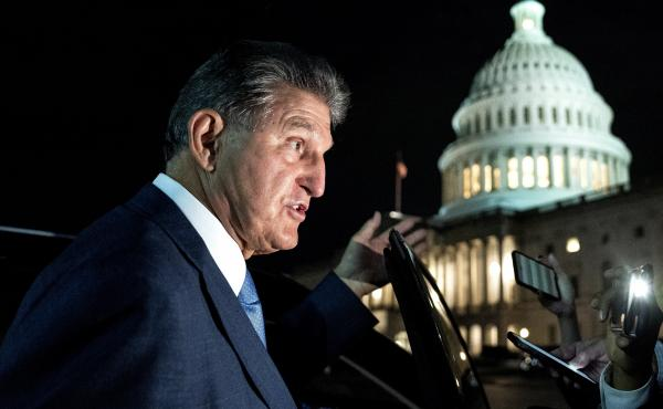 Sen. Joe Manchin, a Democrat from West Virginia, speaks to members of the media while departing the U.S. Capitol on Oct. 7. Manchin has reportedly told the White House that he opposes the key climate measure in Biden's multitrillion-dollar climate and soc