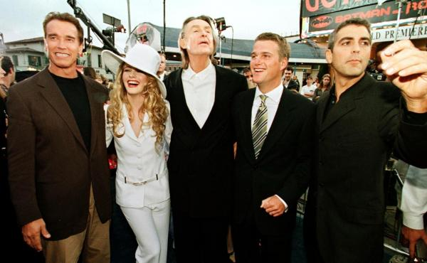 Director Joel Schumacher (center) along with Arnold Schwarzenegger, Alicia Silverstone, Chris O'Donnell and George Clooney (left to right) at the premier for Batman & Robin. The director died Monday at age 80.
