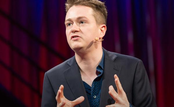Johann Hari speaks on the TED stage.
