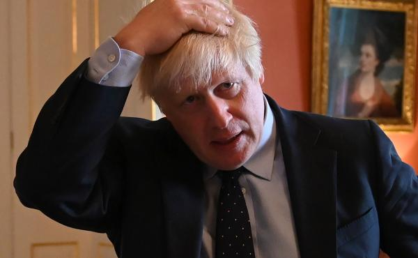 British Prime Minister Boris Johnson, seen hosting health service workers Tuesday at No. 10 Downing St. in London. The same day in the House of Commons, Johnson was dealt a political blow when the defection of a fellow Conservative left him without a work