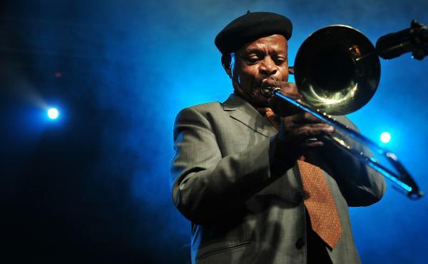 Trombonist Jonas Gwangwa performs in Sandton, South Africa in 2017.