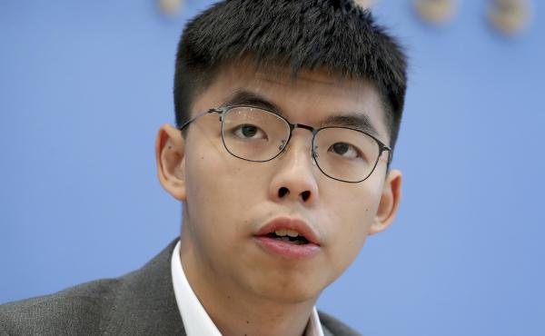 Hong Kong activist Joshua Wong addresses the media during a news conference in Berlin last month. Wong on Tuesday said Hong Kong authorities have disqualified him from upcoming local council elections.