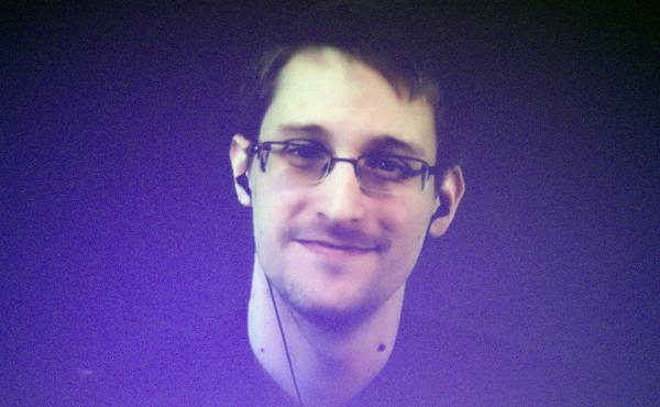 Former U.S. National Security Agency contractor Edward Snowden, shown broadcasting from Moscow in 2014, says he acted as a whistleblower when he shared classified documents with journalist Barton Gellman.