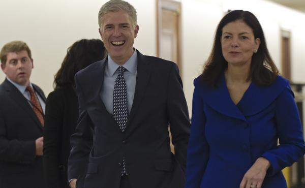 Supreme Court nominee Judge Neil Gorsuch (center) arrives with former New Hampshire Sen. Kelly Ayotte on Capitol Hill last week for a meeting with Sen. Bob Corker, R-Tenn. There are different kinds of conservative judges, from the pragmatist to the origin