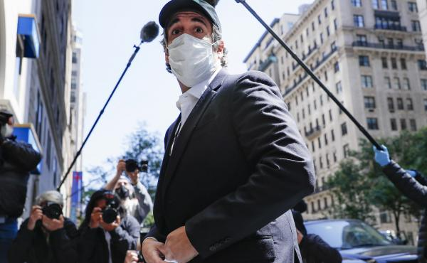 A federal judge found that Michael Cohen's return to prison earlier this month was a violation of his First Amendment rights. Cohen, shown here on release in May, had previously been granted home confinement due to coronavirus concerns.