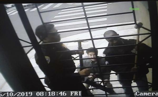 An image from surveillance camera video shows the encounter with police at the home of journalist Bryan Carmody in May. A judge this week quashed a search warrant used by the San Francisco Police Department.