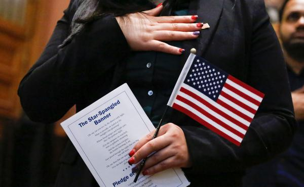 Candidates for U.S. citizenship take the oath of allegiance during a 2017 naturalization ceremony in Jersey City, N.J. A federal judge's order Wednesday could complicate the Census Bureau's plans to finalize census questionnaires and start printing paper