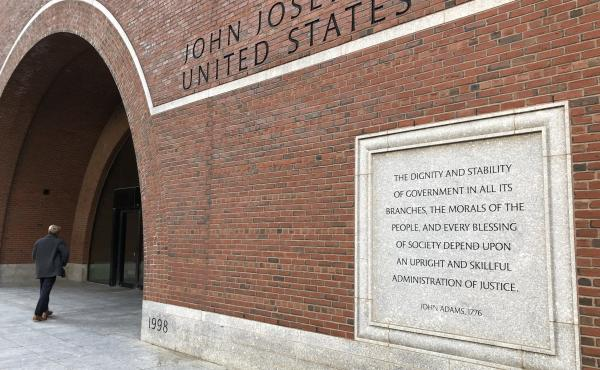 Etchings on the federal courthouse in Boston acclaim a well-administered justice system, but many working in the building say that is getting harder, given the continuing federal shutdown.