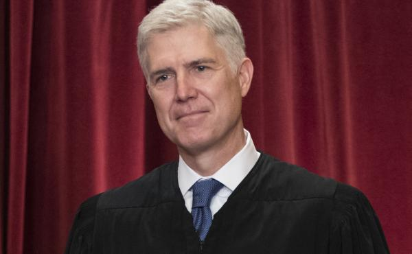 In this June 1, 2017 file photo Supreme Court Associate Justice Neil Gorsuch is seen during an official group portrait at the Supreme Court Building in Washington, D.C.