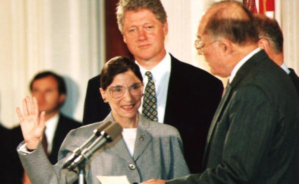 U.S. Supreme Court Justice Ruth Bader Ginsburg (left) takes the oath of office in August 1993 as President Bill Clinton looks on. A new album, Notorious RBG in Song sets events from Ginsburg's life to music.