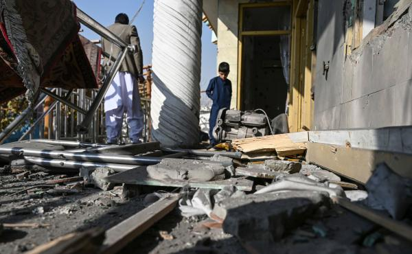 Residents inspect a damaged house after several rockets landed Saturday in Afghanistan's capital, Kabul. The Islamic State claimed responsibility for the attack, which comes the same day as U.S. Secretary of State Mike Pompeo's meeting with Taliban leader