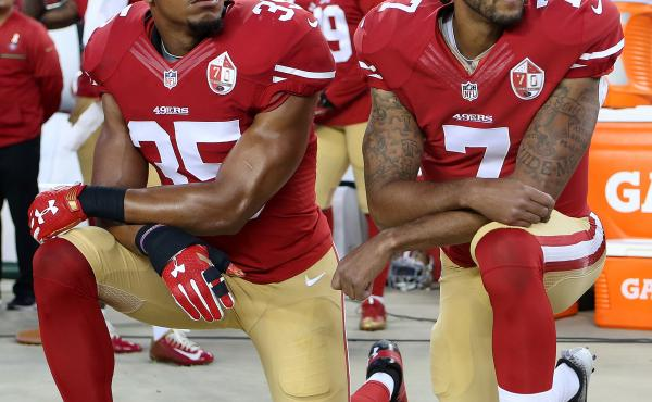 San Francisco 49ers Eric Reid (35) and Colin Kaepernick (7) take a knee during the National Anthem prior to their season opener against the Los Angeles Rams during an NFL football game on Monday, Sept. 12, 2016, in Santa Clara, CA.
