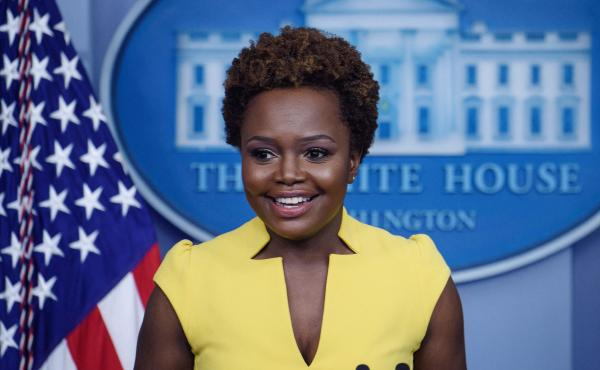 """White House principal deputy press secretary Karine Jean-Pierre arrives for the press briefing Wednesday. """"I believe being behind this podium, being in this room, being in this building, is not about one person,"""" she said of the historic nature of her tur"""