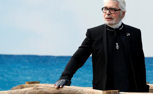 German designer Karl Lagerfeld died in Paris, according to fashion house LVMH, owner of Fendi. He is seen here at the end of Chanel's 2019 women's ready-to-wear show in Paris, where a beach was created to show off Lagerfeld's collection.