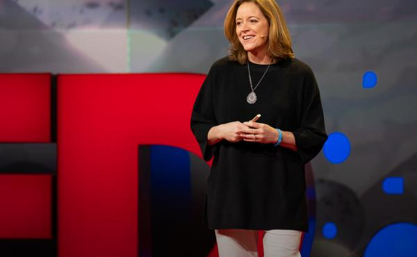 Katie Hood on the TED stage.