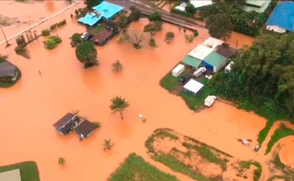 An image from video provided on Saturday by the U.S. Coast Guard shows flooding along Kauai's Hanalei Bay, Hawaii.