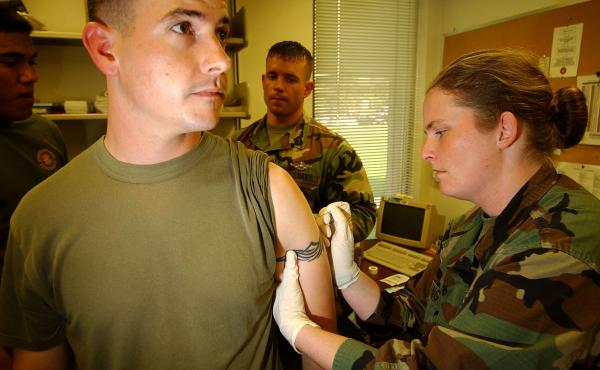 U.S. Marine Sgt. Robert Scoggin gets a vaccination against smallpox in 2003 at Camp Pendleton in California — one of the final steps before deployment overseas.