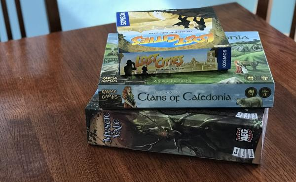 You can't play games like Lost Cities and Mystic Vale with your friends in person right now, but you can still play them online.
