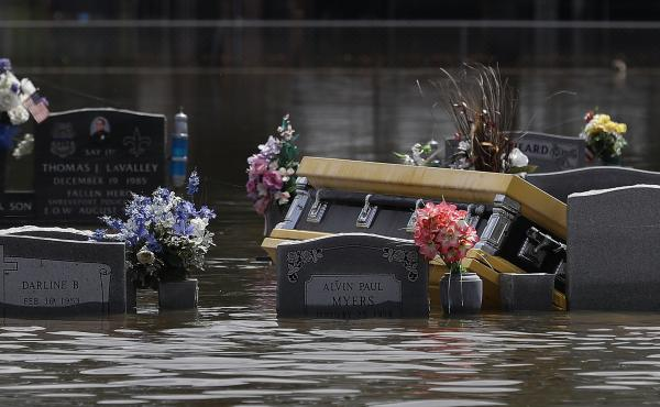 A coffin is seen in a flooded cemetery in August in Sorrento, La.