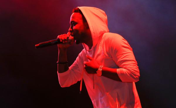"""Kendrick Lamar in 2013. """"Money Trees,"""" from Lamar's 2012 album, good kid, m.A.A.d city, is a song """"that consumes the oxygen and alters the ultra-violet,"""" writes Jeff Weiss."""