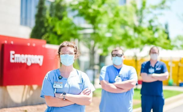 A triage team screens patients outside the Emergency Department at Owensboro Health. The hospital lost two-thirds of its revenue while elective surgeries were halted, but it didn't lay off any workers.
