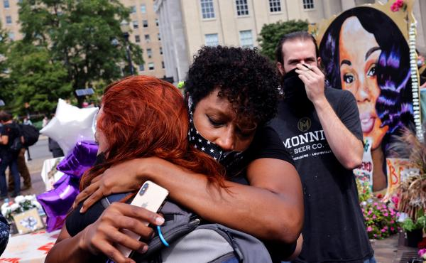 People react after a decision in the criminal case against police officers involved in the death of Breonna Taylor, who was shot dead by police in her apartment, in Louisville.