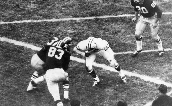 Harvard University's Bruce Freeman tries to run around a teammate and a Yale player and into the end zone after catching a pass during the final 42 seconds of The Game against Yale University at Harvard Stadium in Boston on Nov. 23, 1968.