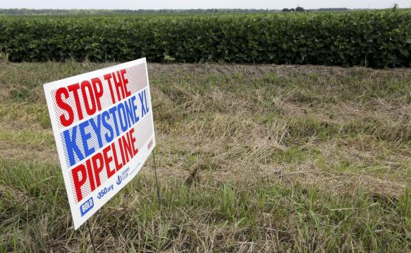 A protest sign sits in the proposed path of the Keystone XL Pipeline in Silver Creek, Neb.
