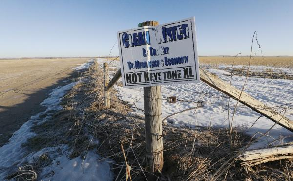A weather-worn sign protesting the Keystone XL pipeline stands in Fullerton, Neb. On Friday the state's Supreme Court dealt the pipeline's protesters a significant defeat, approving an alternate route that runs through Nebraska.