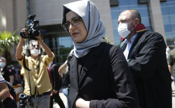 Hatice Cengiz, who was engaged to slain Saudi journalist Jamal Kashoggi, leaves a court in Istanbul on Friday. Two former aides to Saudi Crown Prince Mohammed bin Salman and 18 other Saudi nationals are on trial in absentia over the 2018 killing of the Wa
