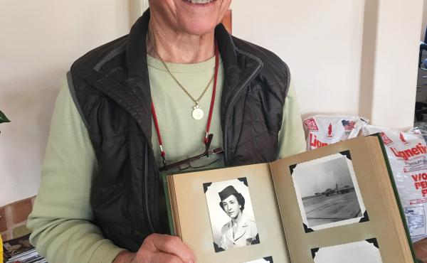 Helen Grace James holds images from her time in the Air Force.