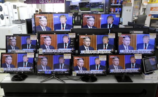 TV screens in a Seoul, South Korea, store on Wednesday show news coverage of the latest exchange of insults between President Trump and North Korean leader Kim Jong Un.