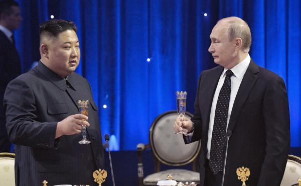 Russian President Vladimir Putin (right) toasts with North Korea's leader Kim Jong Un after their talks in Vladivostok, Russia, on Thursday.