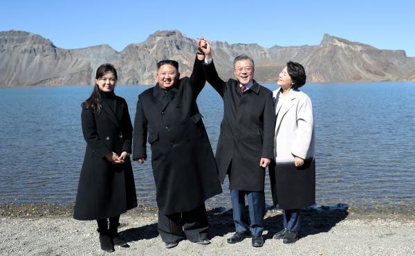 South Korean President Moon Jae-in, first lady Kim Jung-sook, North Korean leader Kim Jong Un and his wife Ri Sol Ju pose for beside the Heaven Lake of Mount Paektu, North Korea, Sept. 20.