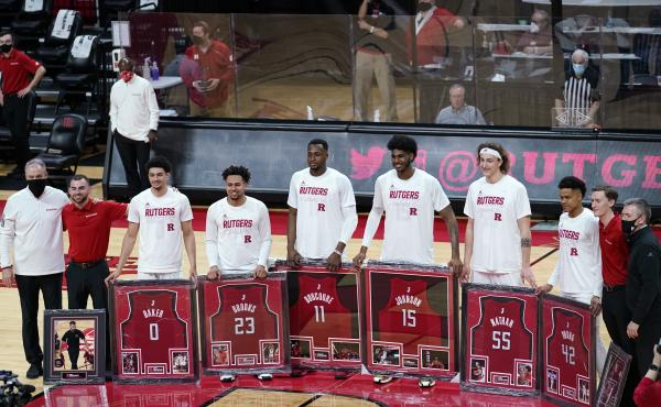 Senior night at Rutgers, where graduating seniors received framed jerseys and applause at the last home game of their careers. Though graduation rates have improved over time, Black basketball players in the NCAA's top division graduate at a rate about 13
