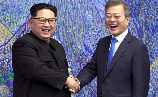 North Korean leader Kim Jong Un (left) poses with South Korean President Moon Jae-in in April at the border village of Panmunjom.