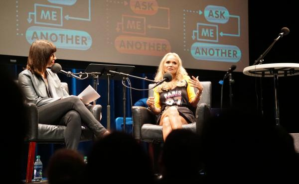 Host Ophira Eisenberg chats with Kristin Chenoweth on Ask Me Another at Cullen Performance Hall at the University of Houston, in Houston, Texas.