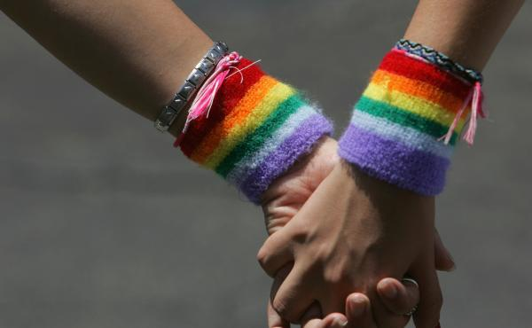 A lesbian couple hold hands during the annual Gay Pride rally, on June 8, 2007. Recent survey data shows that LGBTQ adults in the U.S. are more likely to report higher rates of food and economic insecurity.