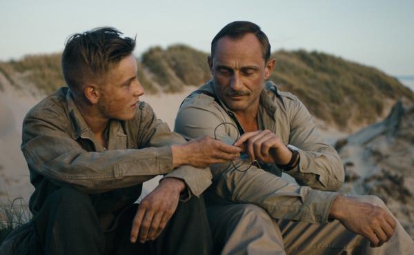 Louis Hofmann (left) and Roland Møller (right) in Land of Mine.