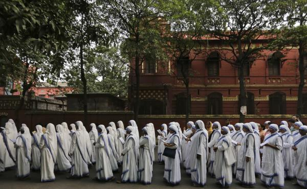 Nuns of the Missionaries of Charity, the order founded by Mother Teresa, walk in annual Corpus Christi procession organized on the Feast of Christ the King in Kolkata, India, in 2016.