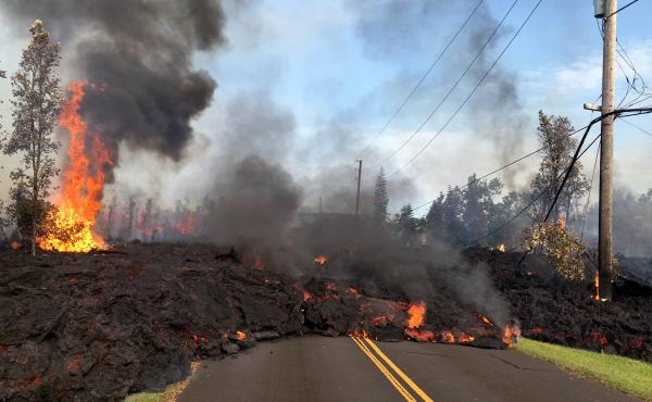 In this handout photo provided by the U.S. Geological Survey, lava from a fissure slowly rolls down the street on Saturday in the Leilani Estates subdivision near Pahoa, Hawaii after the eruption of the Kilauea volcano last week.