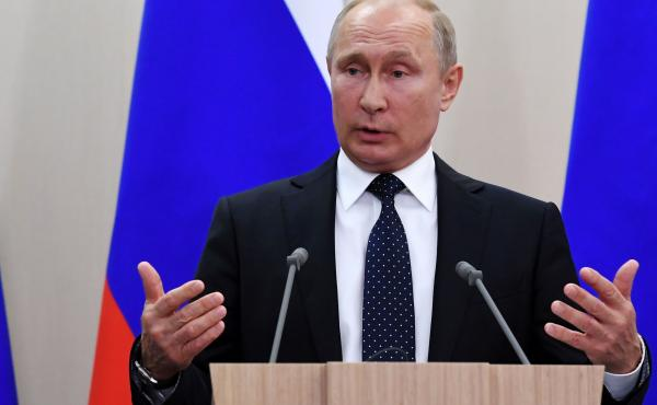 Russian President Vladimir Putin at a press conference on Friday in Sochi. He has served twice served two consecutive terms as president.