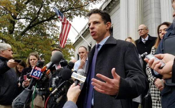 Josh Koskoff, a lawyer representing the families of Sandy Hook shooting victims, speaks outside the Connecticut Supreme Court in this file photo from 2017.