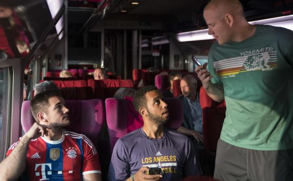This image released by Warner Bros. Pictures shows, from left, Alek Skarlatos, Anthony Sadler and Spencer Stone in a scene from The 15:17 to Paris.
