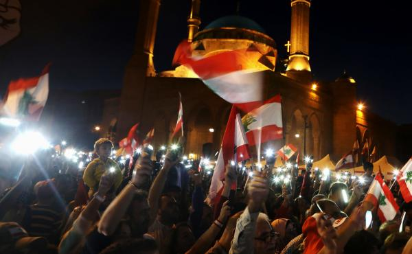 Lebanese anti-government protesters use the light on their mobile phones during a demonstration in downtown Beirut in November. Activists turned to social media platforms to get out their message, streaming protests live on Twitter and highlighting police
