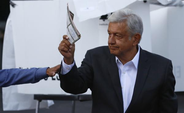 Presidential candidate Andrés Manuel López Obrador, of the MORENA party, shows his ballot to the press before casting it during general elections in Mexico City on Sunday.