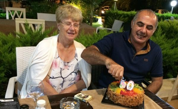Pamela and Afshin Raghebi celebrate a birthday together. Afshin, who was born in Iran, has been stuck overseas, away from his U.S. citizen wife, for more than two years after he flew abroad for an interview at a U.S. Consulate as part of his green card ap